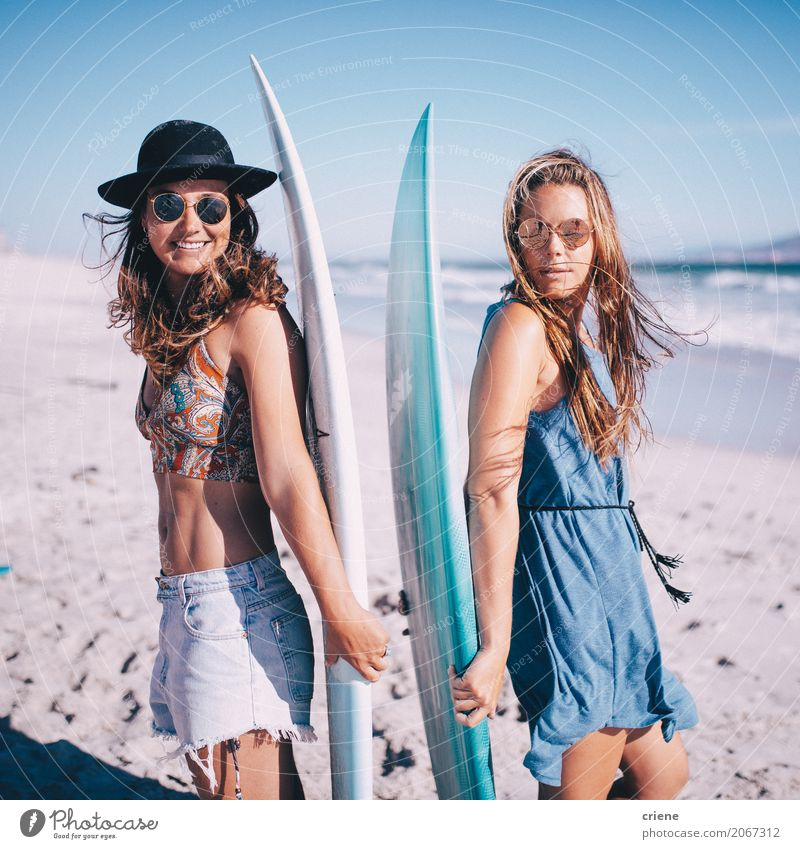 Portrait of two young woman with surfboards on beach Human being Vacation & Travel Youth (Young adults) Young woman Summer Ocean Joy Beach 18 - 30 years Adults
