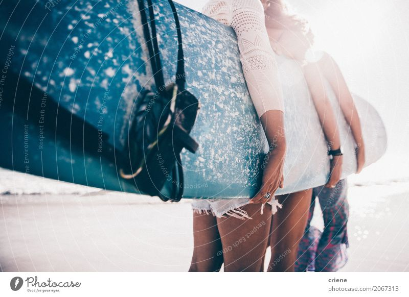 Group of girls holding surfboard on beach Lifestyle Joy Leisure and hobbies Adventure Summer Summer vacation Sun Sunbathing Beach Ocean Sports Feminine Woman
