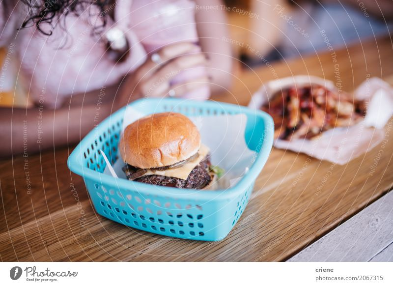 Close-up of Burger and Fries in restaurant Human being Woman Adults Eating Lifestyle Feminine Food Table USA Delicious Restaurant Bread Meat Sense of taste Diet