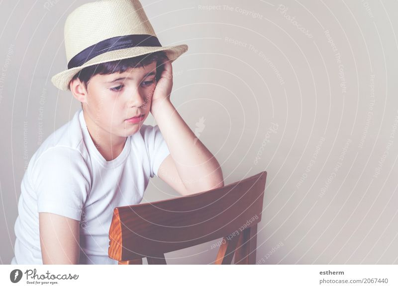 sad child Lifestyle Chair Human being Masculine Child Toddler Boy (child) Infancy 1 3 - 8 years Hat Think Sit Emotions Sadness Concern Grief Homesickness