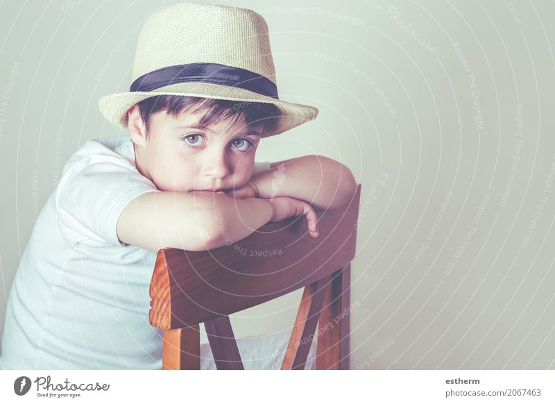 Sad boy sitting in a chair Lifestyle House (Residential Structure) Chair Human being Masculine Child Toddler Boy (child) Infancy 1 3 - 8 years Hat Sit Cuddly