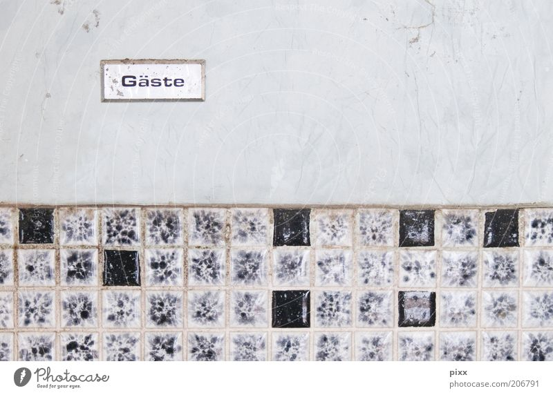 Welcome to the Bathroom Characters Signs and labeling Authentic Dirty Black Stagnating Tile Mosaic Hospitality Guest Toilet Colour photo Interior shot