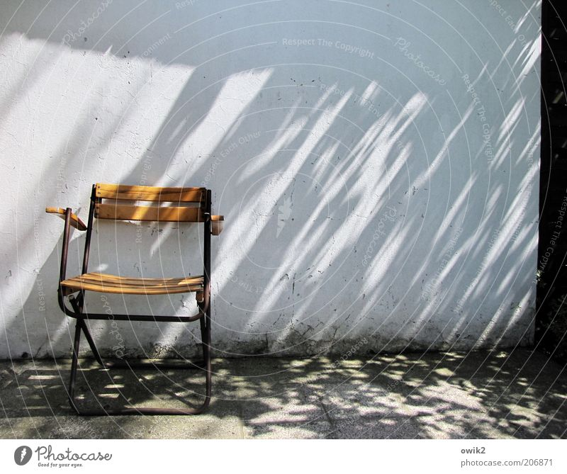 Still not there, the director? Chair Environment Climate Weather Beautiful weather Wall (barrier) Wall (building) Facade Relaxation Sharp-edged Simple Bright