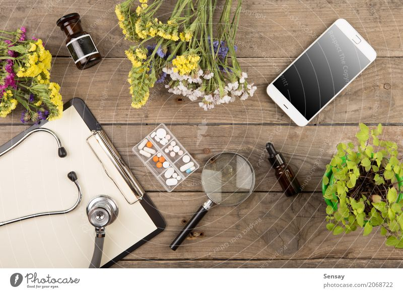 Workplace of a doctor Plant Green White Wood Business Brown Above Work and employment Copy Space Office Table Paper Telephone Medication Science & Research Doctor