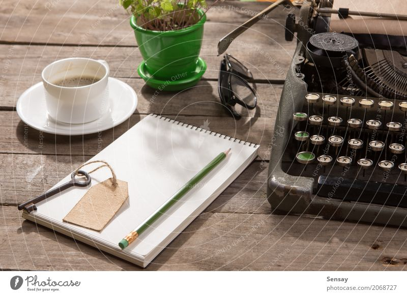 Vintage typewriter on the old wooden desk Old Plant Green Wood Copy Space Office Retro Table Book Paper Information Coffee Write Tracks Tea Desk