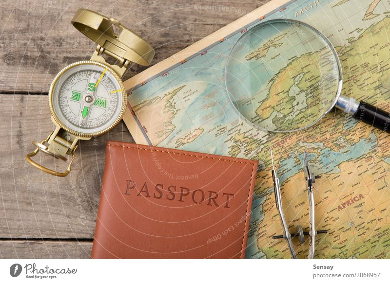 compass and vintage map on the wooden desk Vacation & Travel Trip Adventure Decoration Desk Earth Wall (barrier) Wall (building) Leather Old Historic Retro gold