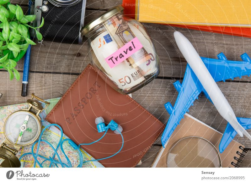 Jar with money for a trave Lifestyle Money Reading Vacation & Travel Tourism Trip Adventure Summer Table Book Plant Street Airplane Accessory Pen Toys Wood