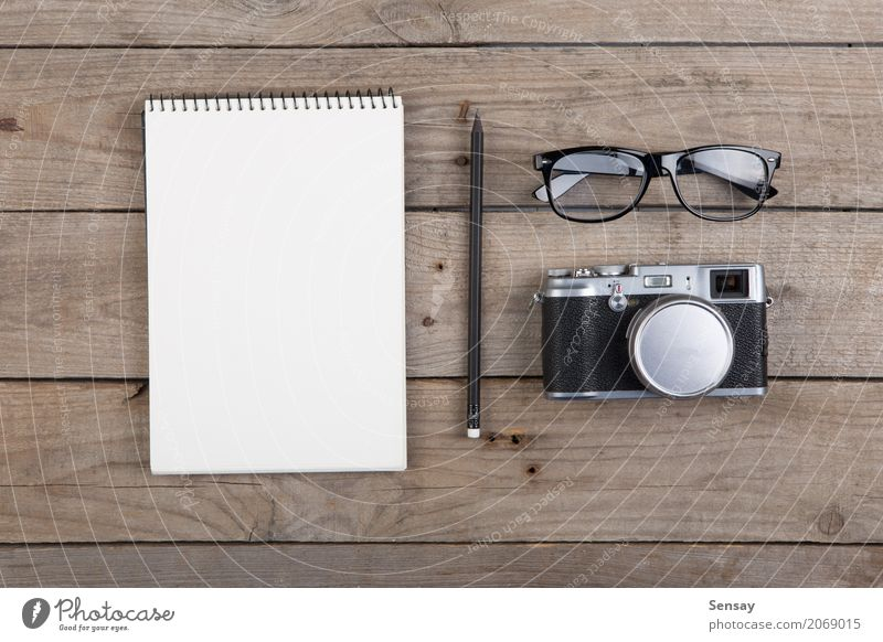 Notepad, glasses and camera on the wooden desk Vacation & Travel Old White Black Wood Business Above Copy Space Office Retro Table Photography Paper