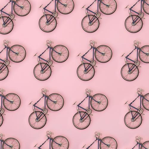 Sport pattern - toy bicycles on pink background Style Design Summer Decoration Wallpaper Sports Group Toys Fitness Bright Above Yellow Pink White Colour