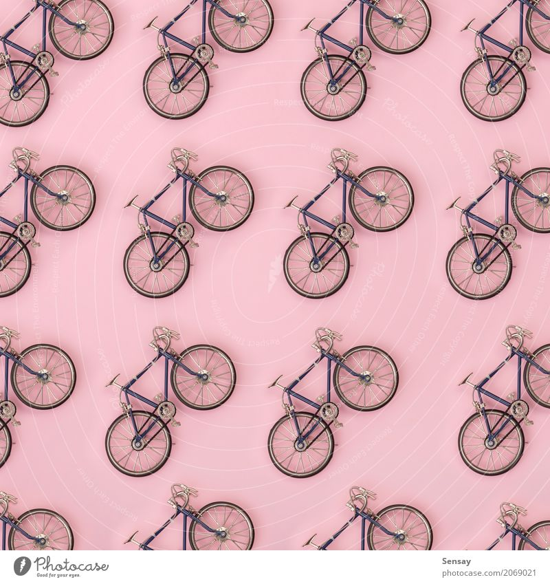 Sport pattern - toy bicycles on pink background Summer Colour White Yellow Sports Style Group Above Design Pink Bright Decoration Creativity Fitness Toys