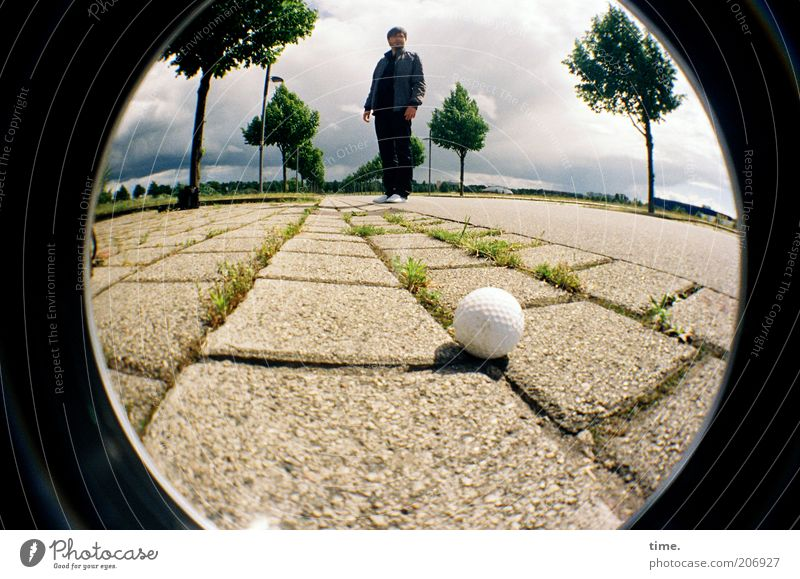 [H10.1] - Everyone should be able to afford a golf ball Golf Golf ball Man Stand Human being Seam Concrete Concrete slab Sidewalk Street Tree Fisheye