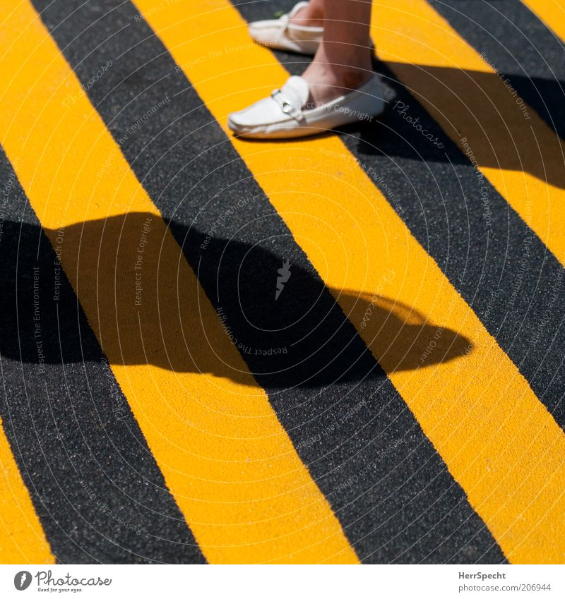 Black and yellow quo vadis? Feet 1 Human being Ground markings Footwear Yellow Striped Warning colour Shadow Grainy Colour photo Exterior shot Light Contrast