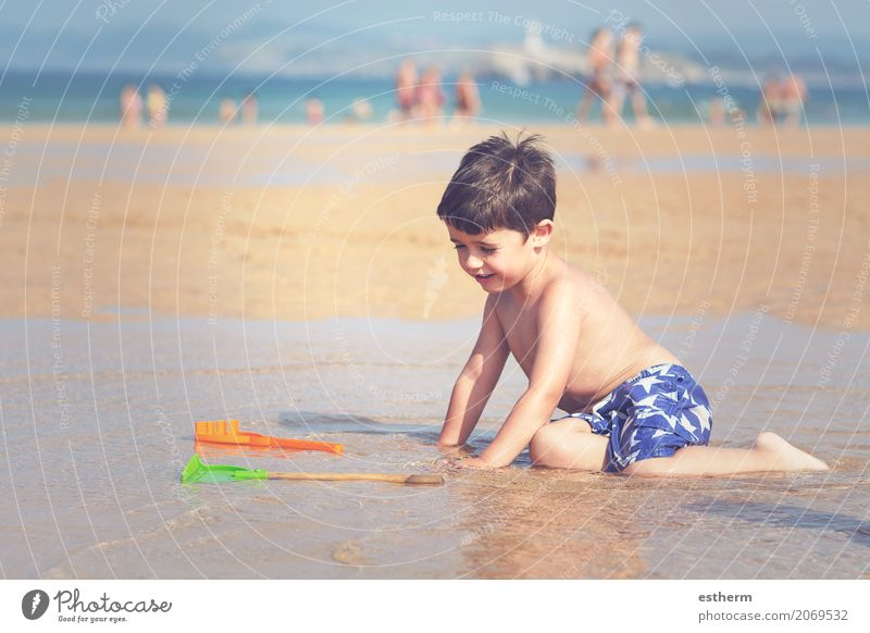 Boy playing on the beach Human being Child Vacation & Travel Summer Sun Ocean Joy Beach Lifestyle Laughter Playing Freedom Masculine Waves Infancy Happiness