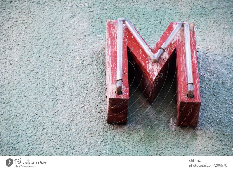 m Wall (barrier) Wall (building) Letters (alphabet) Neon sign Red Old Characters Dirty Decline Decompose Advertising Copy Space left Exterior shot Facade