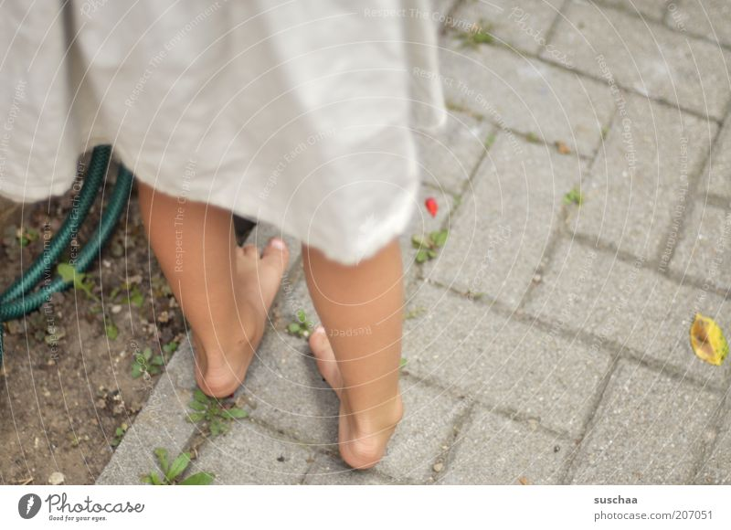 without shoes and stockings ... Feminine Girl Infancy Life 1 Human being Environment Summer Garden Concrete Stand Lanes & trails Contentment Dress Legs Feet