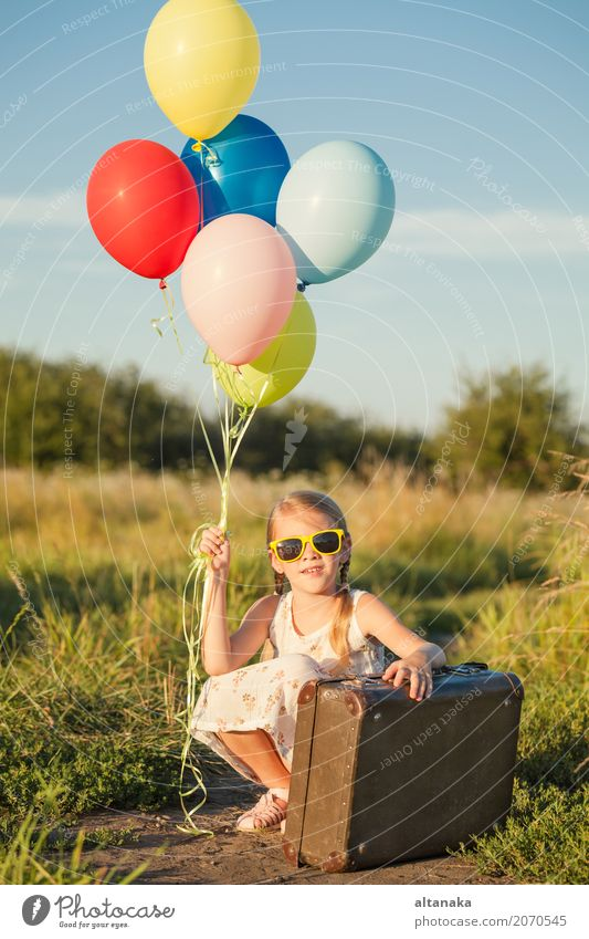 Happy little girl playing on road Lifestyle Joy Leisure and hobbies Playing Vacation & Travel Trip Adventure Freedom Camping Summer Sun Hiking Child Human being
