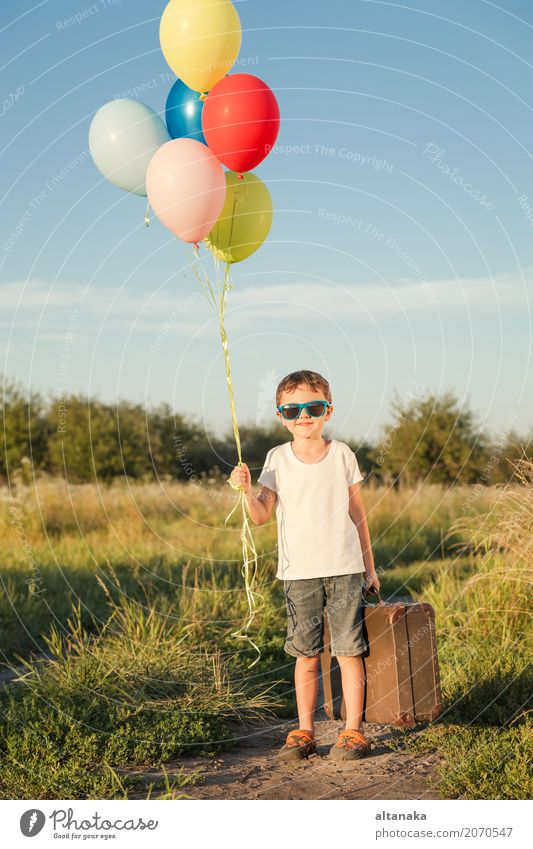 Happy little boy playing on road Lifestyle Joy Leisure and hobbies Playing Vacation & Travel Trip Adventure Freedom Camping Summer Sun Hiking Child Human being