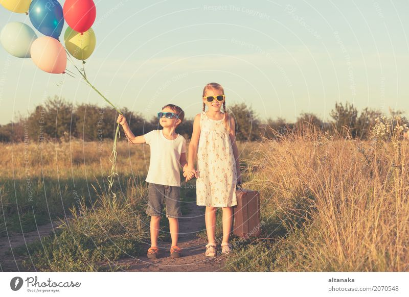 Happy little children playing in the field Lifestyle Joy Leisure and hobbies Playing Vacation & Travel Trip Adventure Freedom Camping Summer Sun Hiking Child