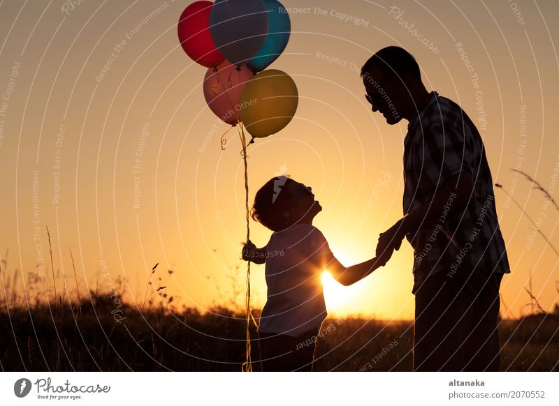 Father and son playing with balloons in the park Human being Child Nature Vacation & Travel Man Summer Sun Hand Joy Adults Street Lifestyle Sports Boy (child)