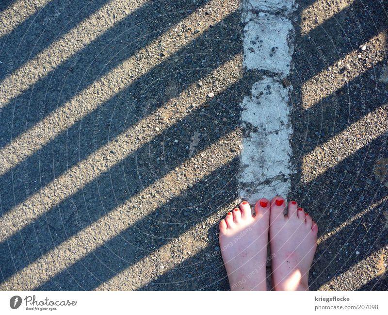 barefooter Feminine Feet Pedestrian Street Lanes & trails Discover Walking Red Nail polish Sideline White Stand Gray Stripe Colour photo Exterior shot