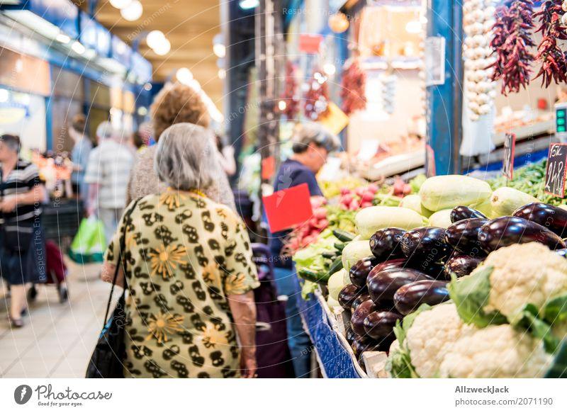 market Markets Vegetable Interior shot Aubergine Cauliflower Senior citizen Stand Wait Vegetable market Covered market Shopping