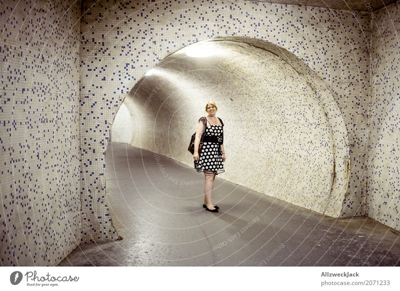 Woman with dress in front of an illuminated underpass Night Evening Dark Lighting Artificial light Young woman 1 Person Dress Tunnel Underpass Passage Pipe