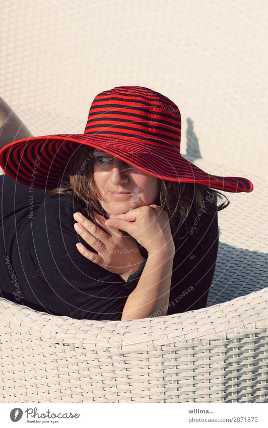 woman with red hat enjoys the sun on white basket couch Vacation & Travel Human being Feminine Woman Adults Life 1 Summer Hat Relaxation Sunbathing Lady