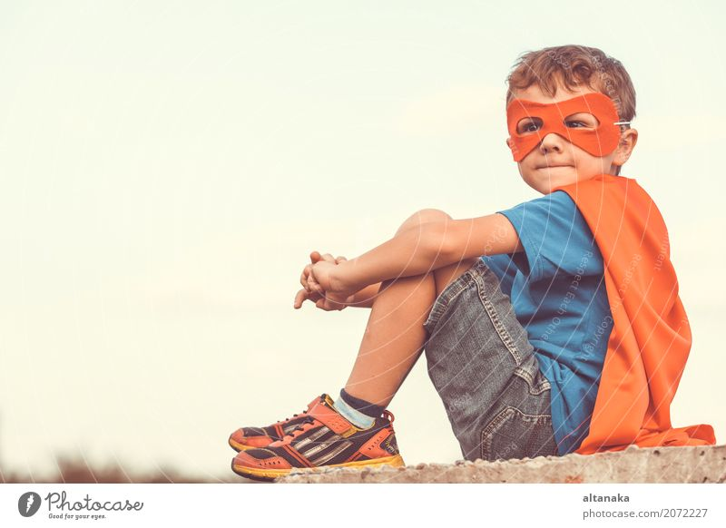 Happy little child playing superhero. Human being Child Sky Vacation & Travel Blue Summer Beautiful Hand Red Joy Lifestyle Emotions Funny Boy (child)