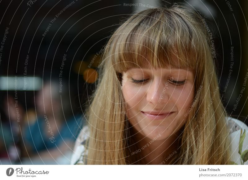 Smiling young woman with pony looks down. Feminine Young woman Youth (Young adults) 18 - 30 years Adults Hair and hairstyles Blonde Bangs Think To enjoy