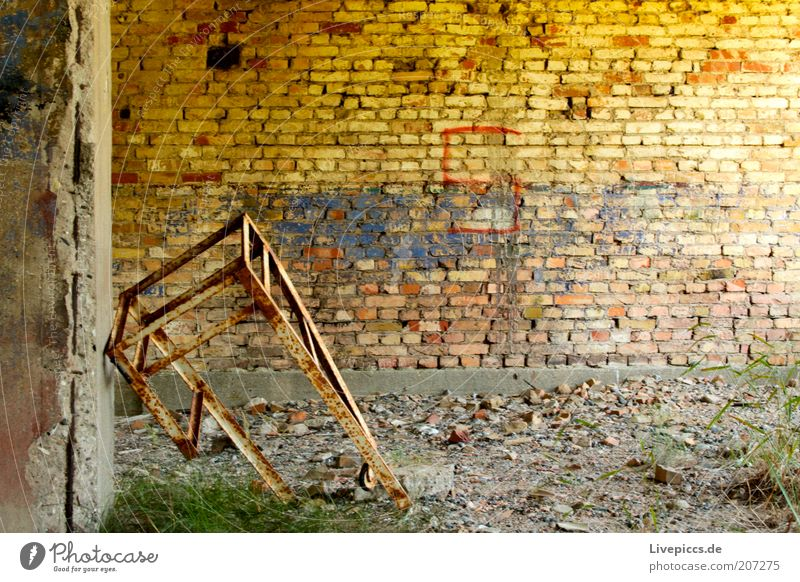solitary rack Wall (barrier) Wall (building) Metal Dirty Broken Brown Yellow Authentic Destruction Colour photo Exterior shot Deserted Central perspective