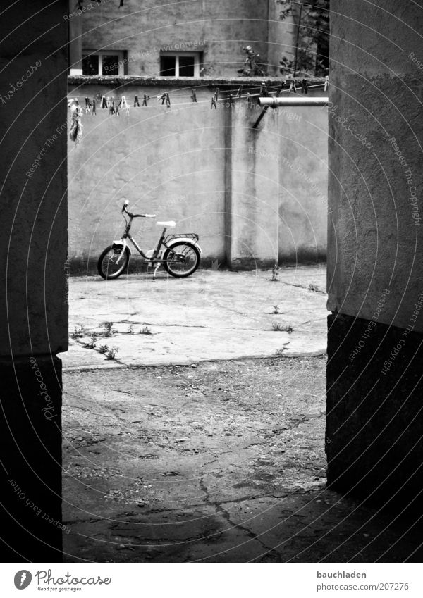 playground Bicycle Vienna Deserted Wall (barrier) Wall (building) Facade Interior courtyard Courtyard Kiddy bike Environment Black & white photo Exterior shot