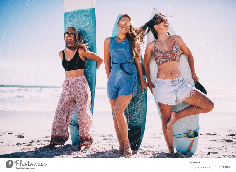 Group of girls having fun with surfboards on beach Human being Woman Vacation & Travel Youth (Young adults) Summer Sun Ocean Joy Beach Adults Warmth Sports