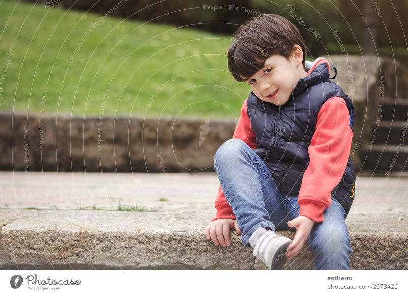 Smiling boy in the park Human being Child Joy Lifestyle Emotions Funny Laughter Playing Happy Garden Leisure and hobbies Park Infancy Sit Happiness
