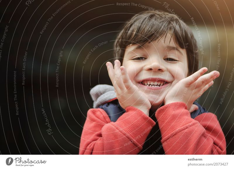 Smiling boy in the park Human being Child Vacation & Travel Joy Lifestyle Emotions Boy (child) Laughter Playing Feasts & Celebrations Friendship Dream Masculine