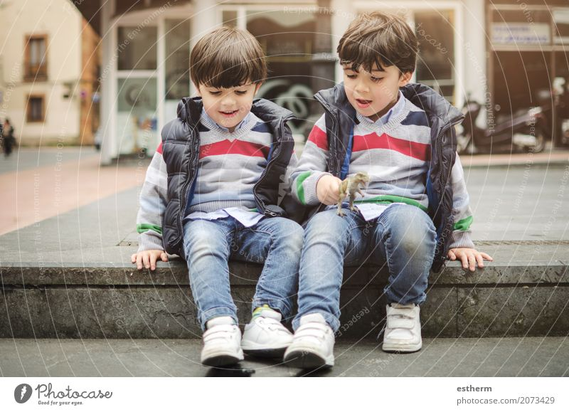 Smiling twins brothers playing Human being Child Joy Lifestyle Love Emotions Laughter Family & Relations Think Together Friendship Leisure and hobbies Masculine