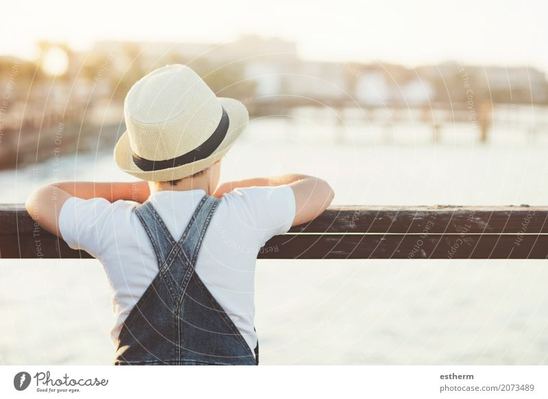 Thoughtful boy with hat Human being Child Vacation & Travel Loneliness Calm Beach Lifestyle Sadness Emotions Coast Boy (child) Freedom Think Infancy Adventure Curiosity
