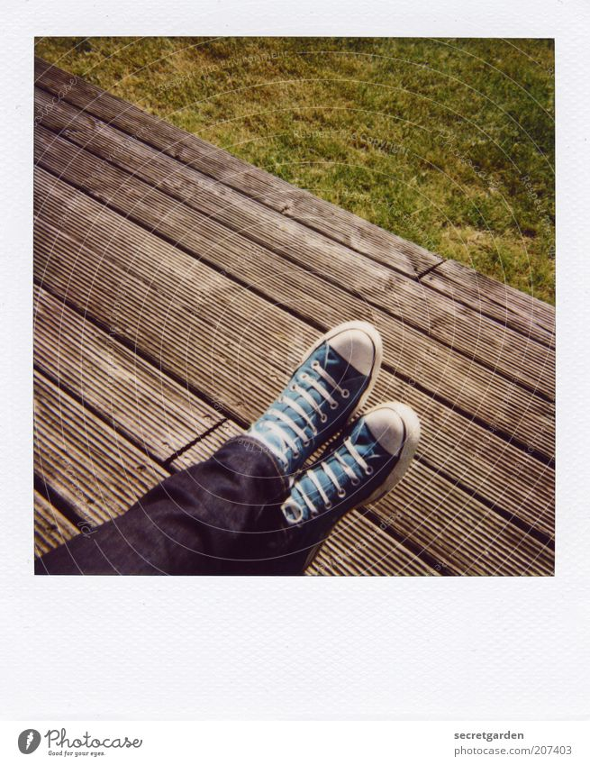 [H 10.1] Count's feet. Well-being Contentment Relaxation Calm Summer Human being Legs Feet Beautiful weather Grass Terrace Jeans Footwear Sneakers Chucks Wood