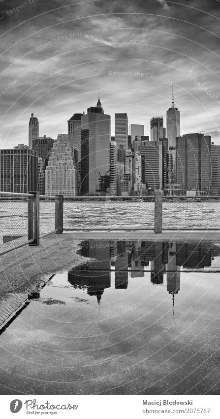 Manhattan skyline reflected in a puddle. Sky Vacation & Travel Town White Black Architecture Street Life Building Gray High-rise Retro USA Skyline Downtown