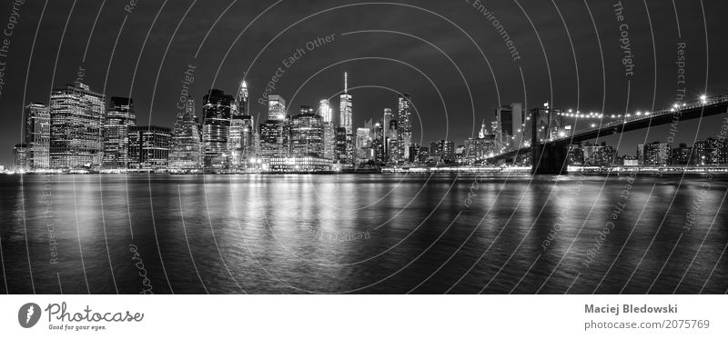 Manhattan panorama at night. Town Skyline High-rise Bridge Building Architecture Tourist Attraction Landmark Rich Gray Black White Vacation & Travel Society