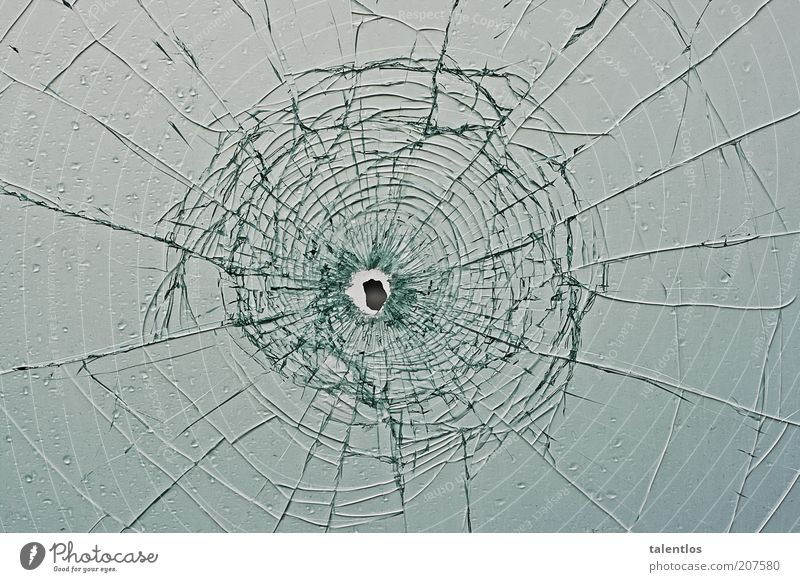 bullet hole Window Glass Broken Smashed window broken glass Colour photo Exterior shot Abstract Pattern Structures and shapes Copy Space left Copy Space right