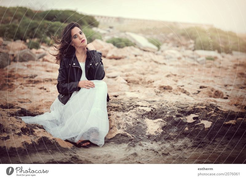 Pensive woman sitting on the rocks Lifestyle Elegant Style Beautiful Wellness Human being Feminine Young woman Youth (Young adults) Woman Adults 1 18 - 30 years