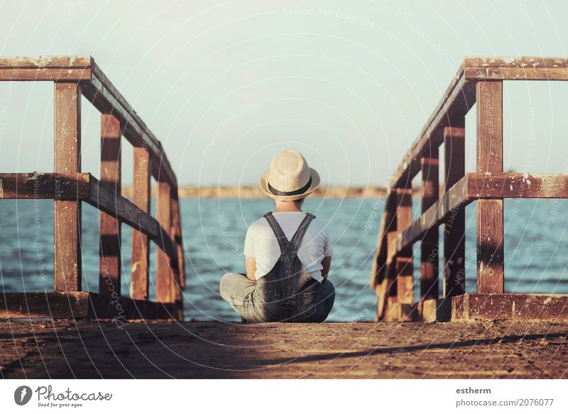 Pensive boy looking at the sea Human being Child Vacation & Travel Loneliness Beach Lifestyle Sadness Coast Boy (child) Freedom Think Lake Dream Masculine Infancy Sit