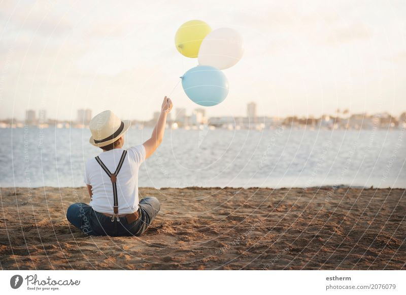 little boy with colorful balloons Human being Child Vacation & Travel Loneliness Joy Beach Lifestyle Emotions Coast Boy (child) Happy Freedom Dream Masculine