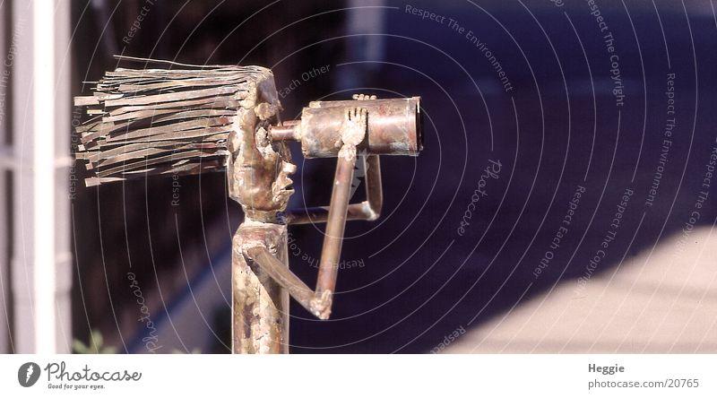 The Television Binoculars Telescope Things blowing hair tin figure