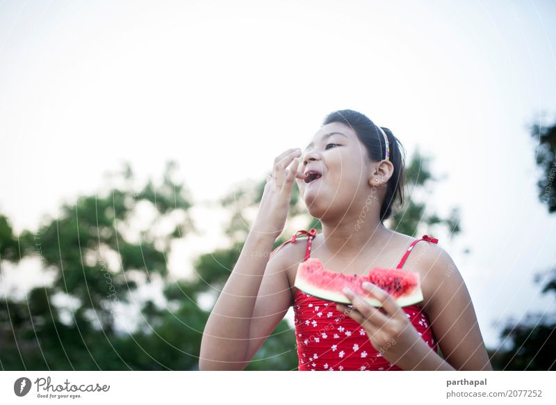 Girl eating watermelon and making fun Food Nutrition Eating Lifestyle Joy Healthy Healthy Eating 1 Human being 8 - 13 years Child Infancy Red Happiness Summer
