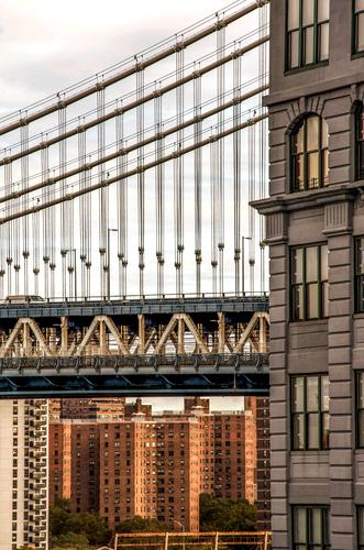 It's underneath... Sightseeing City trip New York City Manhattan Town Downtown Skyline High-rise Bridge Suspension bridge Tourist Attraction Manhattan Bridge