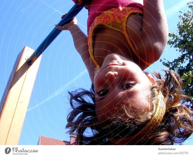 the world is upside down Child Playing Playground Inverted Dangerous Blue sky Joy happy Speed