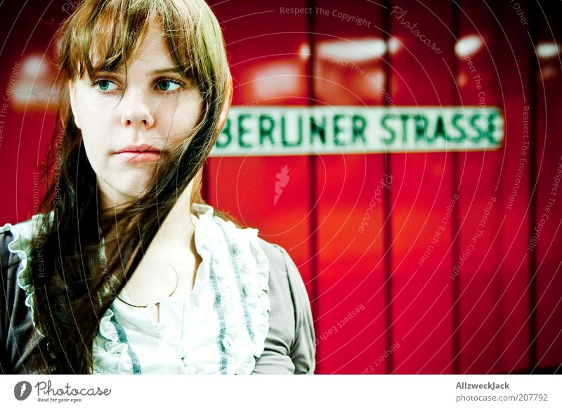 Youth (Young adults) Red Loneliness Berlin Feminine Wait Adults Pink Wind Signs and labeling Characters Natural Train station Traffic infrastructure Brunette