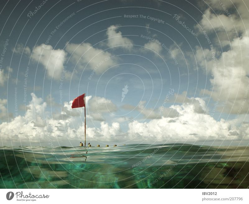 Red flag in paradise IV Summer Summer vacation Ocean Island Waves Coral reef Leisure and hobbies Maldives Asia Flag Clouds Sky Indian Ocean Vacation & Travel