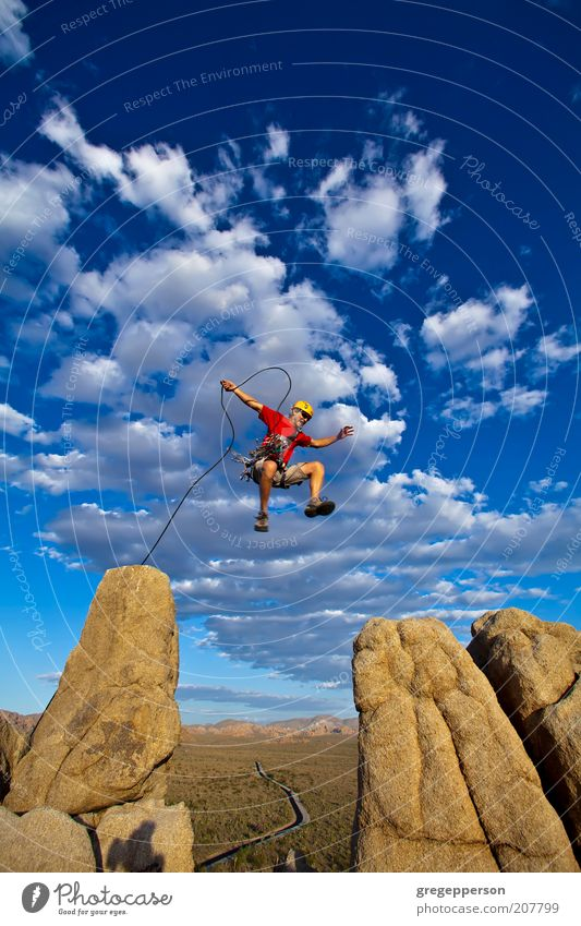 Climber jumping across gap. Adventure Climbing Mountaineering Rope Man Adults 1 Human being 30 - 45 years Nature Peak Helmet Jump Athletic Tall Self-confident